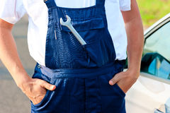 Wrench sticking out of the pocket mechanic overalls Royalty Free Stock Photo