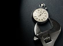 Wrench and stopwatch Stock Photography