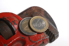 Wrench. The wrench tight euro money Royalty Free Stock Photography