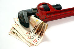 Wrench. The wrench tight euro money Royalty Free Stock Images