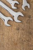 Wrench tool on wood Royalty Free Stock Photos