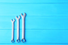 Wrench tools. On blue wooden table stock photos