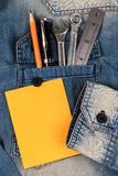 Wrench tools on a denim workers with blank note paper for text, Father Day. Stock Photo