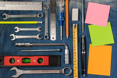 Wrench tools on a denim workers with blank note paper for text. Flat lay style. Closeup view stock photos