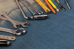 Wrench tools on a denim workers with space for text. Happy Labour Day. Top view Stock Images