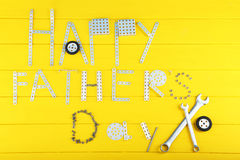 Wrench tools. For fathers day on yellow wooden table stock images