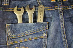 Wrench tools and ruler in the pocket jeans Royalty Free Stock Photography