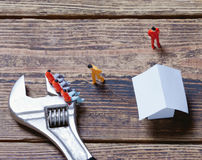 Wrench, toy people and paper Royalty Free Stock Photo