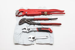 Wrench whit work gloves Royalty Free Stock Image