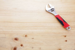 A wrench on a wood table Stock Image