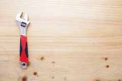 A wrench on a wood table Royalty Free Stock Photo