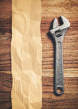 Wrench on wooden background Stock Photo