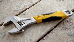Wrench on wooden boards Stock Photography