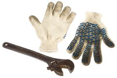 Wrench and work gloves Stock Images