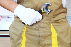 Wrench in worker hand closeup Royalty Free Stock Photography
