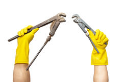 Wrench in yellow rubber gloves Stock Photography