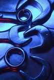 Wrenches. Industrial bolts on metal plate under low light stock photo