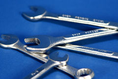 Wrenches. Five wrenches on a blue background Stock Photography