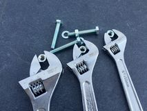 Wrenches on black slate royalty free stock image