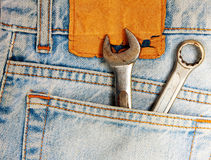 Wrenches in Blue Jeans Pocket. The Wrenches in Blue Jeans Pocket Royalty Free Stock Photos