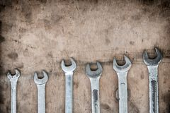 Wrenches on garage wall, set of wrenches handy industrial tool,old wrenches in mechanic workshop,handy tool for motor vehicle. Mechanic use to fix motorcycle stock image