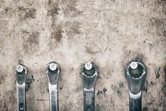 Wrenches on garage wall, set of wrenches handy industrial tool,old wrenches in mechanic workshop,handy tool for motor vehicle. Mechanic use to Fix motorcycle royalty free stock images