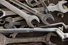 Wrenches on garage wall, set of wrenches handy industrial tool,old wrenches in mechanic workshop,handy tool for motor vehicle. Mechanic use to fix motorcycle stock photo