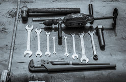 Wrenches and a hand drill. On sheet steel Royalty Free Stock Photography
