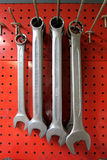 Wrenches hang. From hooks on red pegboard Stock Photography