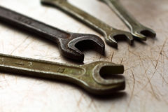 Wrenches on a metal background stock image