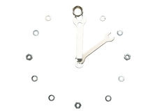 Wrenches, nuts, isolated, made in a form of a clock stock images