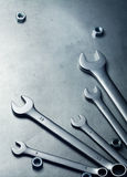 Wrenches, nuts are on a metal plate Royalty Free Stock Photos
