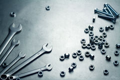 Wrenches, nuts and screws. On a metal plate Royalty Free Stock Image