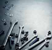 Wrenches, nuts and screws on a metal plate Stock Image