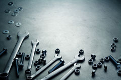 Wrenches, nuts and screws on a plate. Wrenches, nuts and screws on a metal plate Stock Image