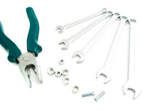 Wrenches, pliers and bolts on white Royalty Free Stock Images