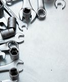 Wrenches on the scratched metal background royalty free stock photo
