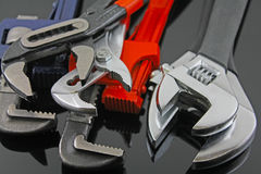 Wrenches. Six various wrenches on a black reflective back ground Stock Photos