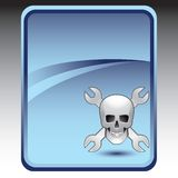 Wrenches and skull on blue background Royalty Free Stock Images