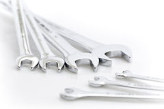 Wrenches or spanners. Details of several different size of box-end or open-end wrenches or spanners on white background Stock Photos