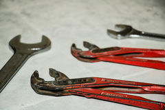 Wrenches, spanners. On the dirty floor Stock Photography