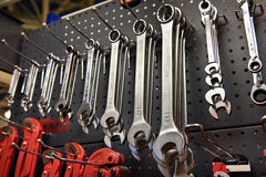 Wrenches on stand in store or workshop Stock Photo