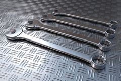 Wrenches on steel floor Royalty Free Stock Photos