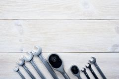 Wrenches on a textural white wooden background. Space for the test royalty free stock image