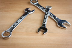 Wrenches on wood. Wrenches on a wooden work bench Stock Images