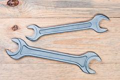 Wrenches on a wooden board. Stock Photos