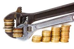 Wrenchs i monety Obraz Royalty Free