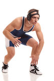 Wrestler. In a blue singlet. Studio shot over white Royalty Free Stock Image
