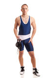 Wrestler. In a blue singlet. Studio shot over white Royalty Free Stock Images