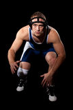 Wrestler. In a blue singlet. Studio shot over black Stock Images